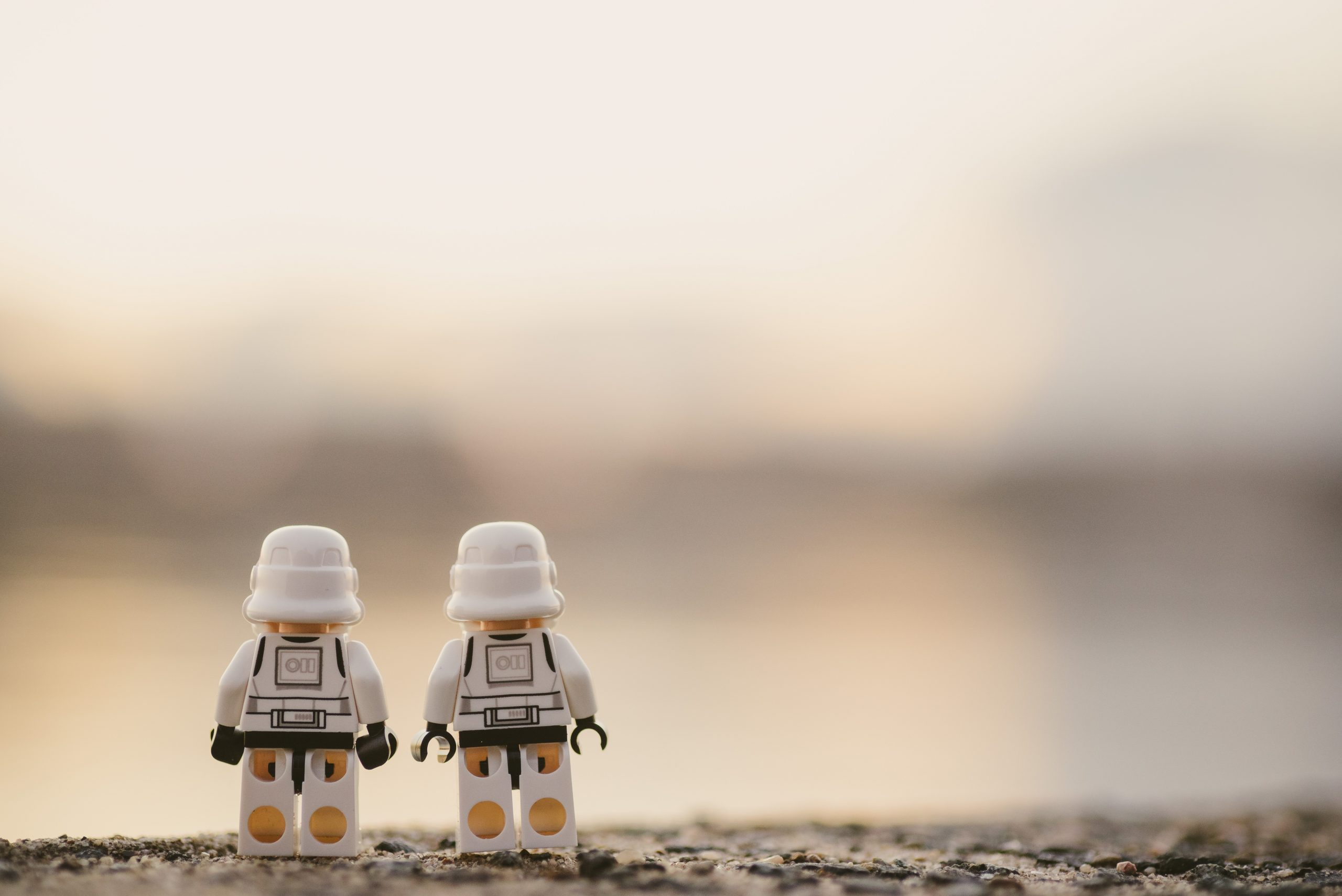 Two lego characters representing a client and creative agency