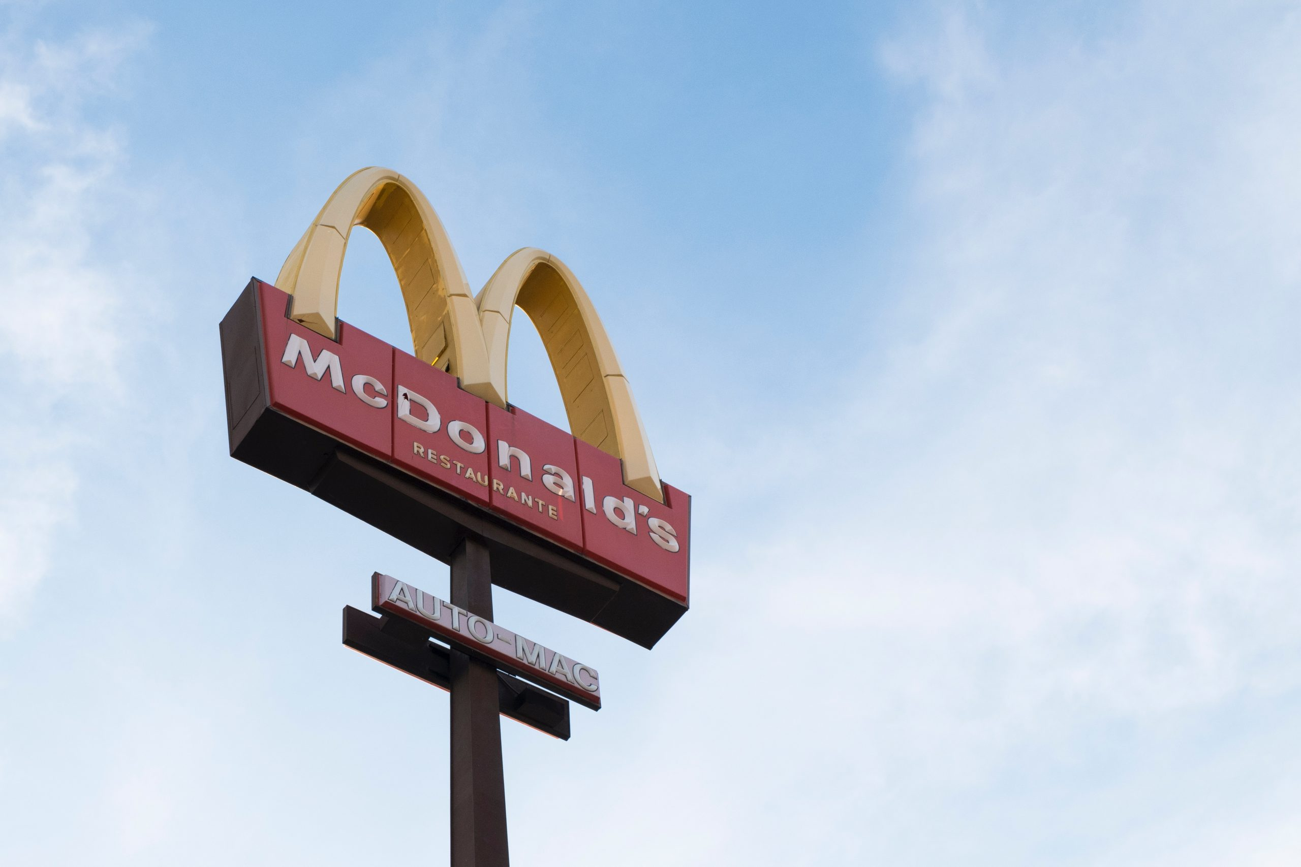 McDonald's sign with the blue sky as a background
